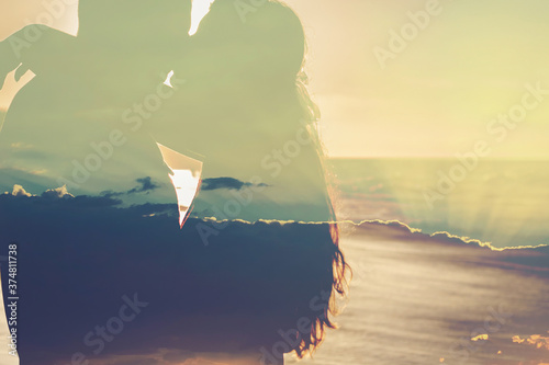 Canvastavla Loving couple man and woman on the shore of the sea, sea, beach resort, clouds s