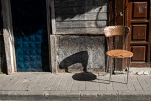 Shadow Of A Chair On A Wall An...