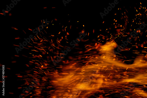 Fotografie, Obraz fire flame with sparks on black background