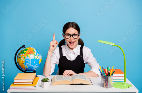 Fototapeta Excited high school girl sit table prepare academic lecture test exam get incred