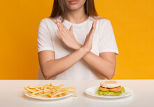 Unrecognizable Woman Showing Stop Gesture, Refusing Unhealthy Fast Food