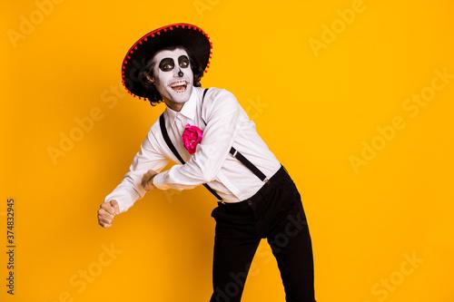 Photo of handsome funky man make traditional latin dance pretend have maracas ro Fototapeta