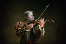 Playing Violin. Young Man As Johann Bach Isolated On Dark Green Background. Retro Style, Comparison Of Eras Concept. Beautiful Male Model Like Historical Character, Great Music Composer, Old-fashioned