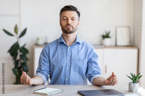 Obraz Office Zen. Relaxed Male Entrepreneur Meditating At Workplace, Coping With Work Stress - fototapety do salonu