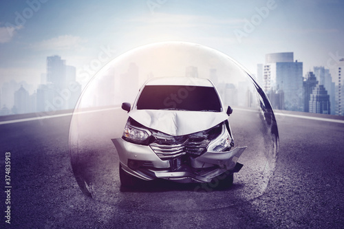 Silver car with broken bumper in protective bubble Canvas Print