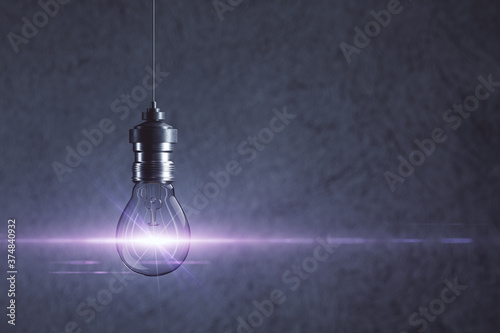 Fototapeta Glowing light bulb