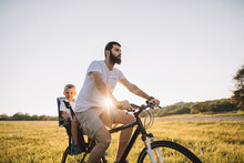 Father And His Son Cycling Tog...