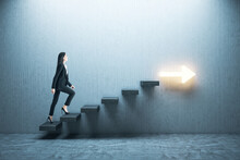 Young Businesswoman Moving Up On Stairs With Arrow