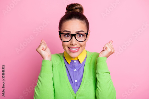 Fototapeta Close-up headshot photo of lovely attractive girl raised fists smiling crazy loo