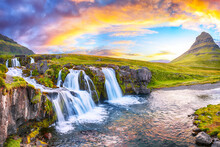 Fantastic View On Kirkjufellsfoss Waterfall  Near Kirkjufell Mountain At Sunset