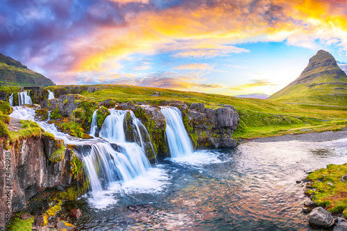 Fantastic view on Kirkjufellsfoss waterfall  near Kirkjufell mountain at sunset Fototapete
