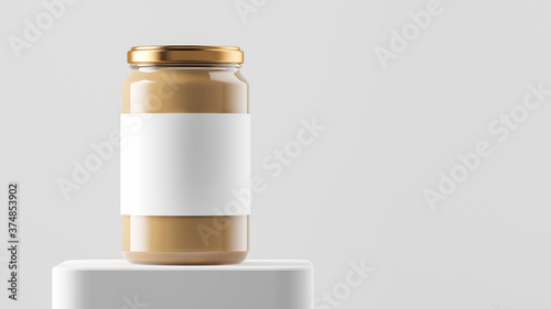 Carta da parati Big tall transparent glass jar with copper metal cap and blank label filled by nut butter on the podium over white background