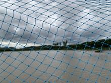 Mesh Patterned Blue Net Fence