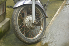 Close Up Of A Wheel Of A Motorcycle With Rusted Spokes And Old Tyre Selective Focusing