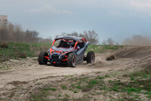 UTV Buggy In The Action On Sand In Summer