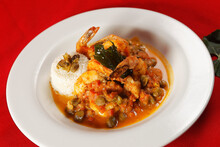 Shrimp With Caper, Chaya Leaf And Steamed Rice.