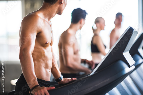 Cuadros en Lienzo Gym fitness trainer concept, health lovers exercise in sports gym for a strong h
