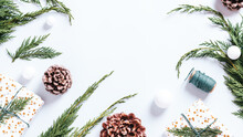 Stylish White And Green Christmas Flat Lay With Huge Pine Cones, Cedar Branches, Presents And Decorations. Frame With Christmas Ornaments And Natural Elements, Copy Space