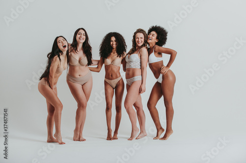 Fotografering Group of women with different body and ethnicity posing together to show the woman power and strength