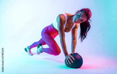 Woman training with the exercizes ball in the gym Wallpaper Mural