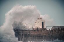 Large Wave Crashing Over Building