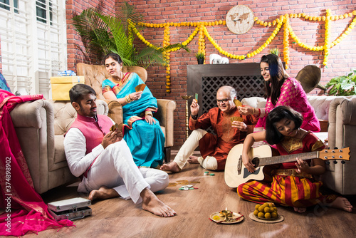 Indian family playing Three Cards or Teen Patti in Diwali or Deepavali festival Canvas Print