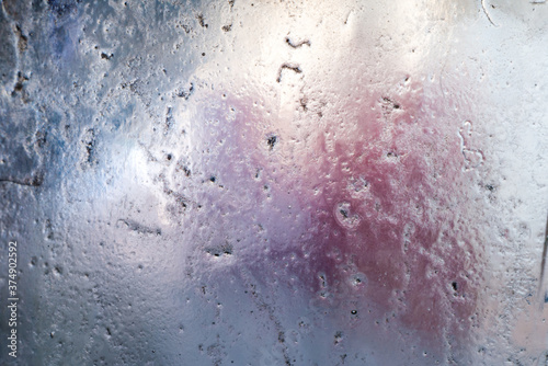 Fotografie, Obraz Abstract background of frosted pitted glass, with muted colors behind