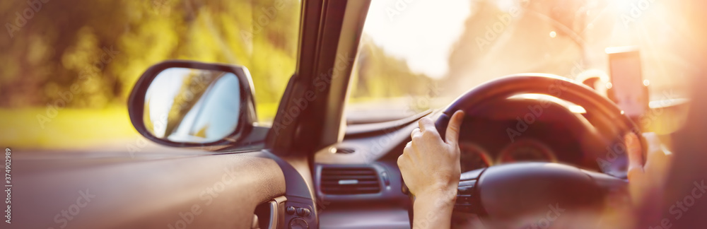 Fototapeta Driver driving a car on asphalt road in summer day