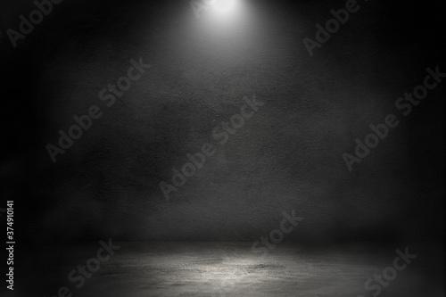 Fotografie, Obraz Empty space studio dark room of Concrete floor with spot lighting and smoke in black background