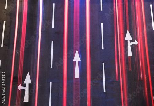 Canvas Night traffic on road. White arrow sign painted on black asphalt