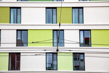 Electrical Wires Of City Tram. Electric Tram Trolley Pole Railway Electrification Overhead System. Colorful Facade Of The New Apartment Building. Modern Architecture, Residential Building