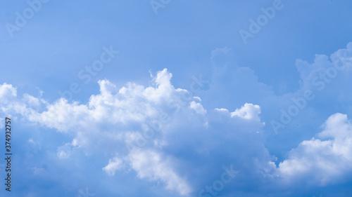 Fototapeta huge clouds float on the blue sky.