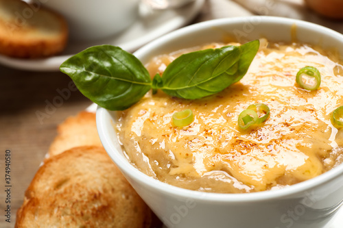 Tasty homemade french onion soup served in ceramic bowl, closeup Wallpaper Mural