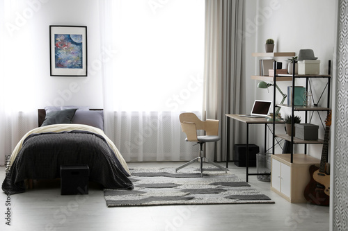 Fotografija Modern teenager's room interior with workplace and bed