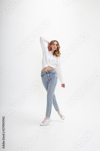 portrait of young caucasian woman with long hair in shirt, jeans, isolated on white studio background Wallpaper Mural