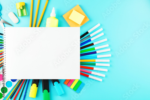 An album for creative development at school, with stationery on a cyanide background Fototapeta