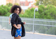 canvas print picture - afro american Woman Walking Black Bag