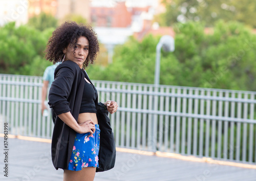 Vászonkép afro american Woman Walking Black Bag