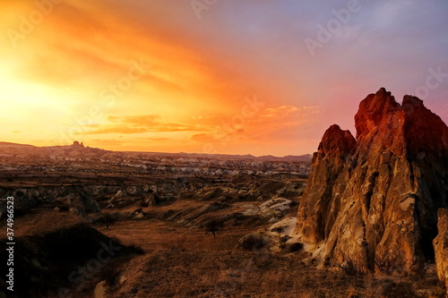 Amazing sunset view in the valley Cappadocia Turkey Mountains and rock formations in Cappadocia.