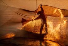 Silhouette Of A Fisherman Chec...