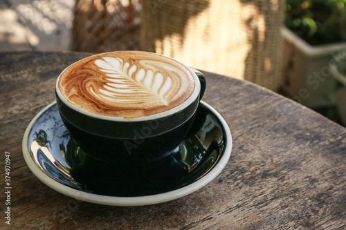 A cup of coffee with latte art on top Slika na platnu
