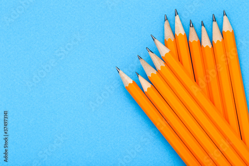 Yellow pencils on blue background Canvas Print