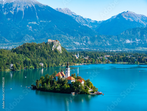 Fotografiet Aerial view on the Pilgrimage Church of the Assumption of Maria on the Lake Bled