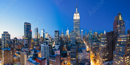 Midtown Manhattan, elevated dusk view towards the Empire State Building, Manhattan, New York City, New York, United States of America - 374993379