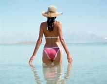 Woman In Bikini Standing In The Dead Sea. Israel