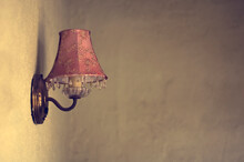A Lone Pink Vintage Lamp On A ...