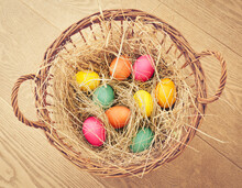 Soft And Naturally Coloured Easter Eggs In A Basket Padded Out With Straw