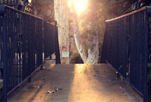 Brightly Lit Gated Concrete Pa...