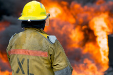 A Firefighter Faces A Wall Of ...