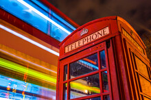 Telephone Box And Blurred Bus ...